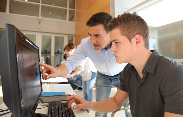 Employer and student with computer